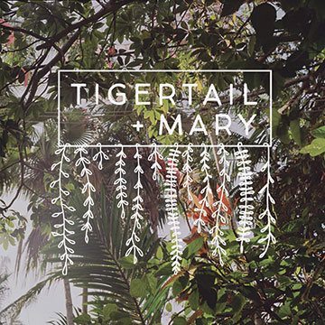 tigertail + mary logo over forest background